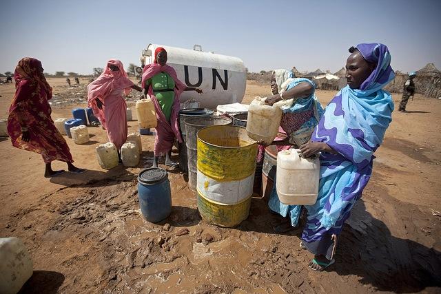 women near water truck(1)